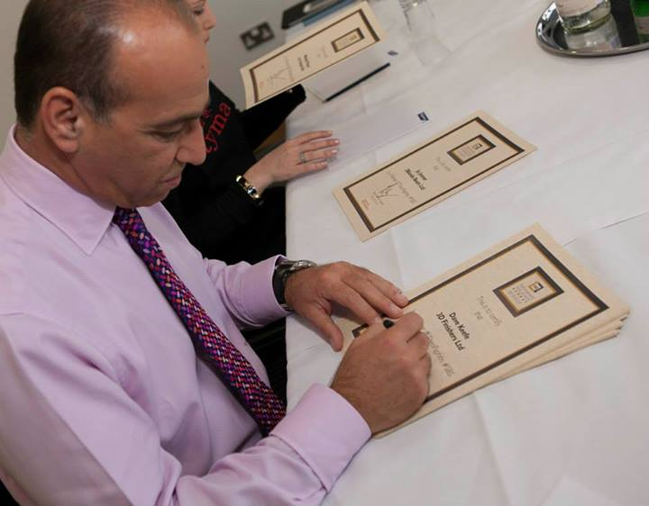 Theo Paphitis signing certificates